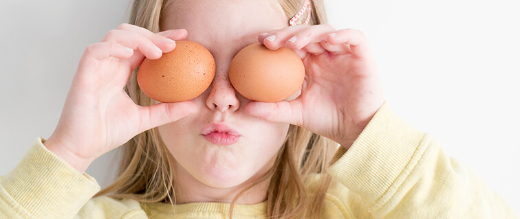 Girl with eggs on eyes
